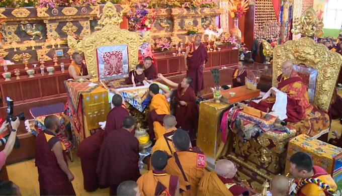 HH Karma Kuchen Rinpoche offering mandala to His Holiness the Fourth Penor Rinpoche