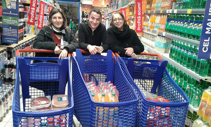 Staff of the Romania orphanage shopping for the Christmas meal